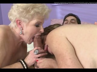 Two mature ladies share junior guy s cock and cum