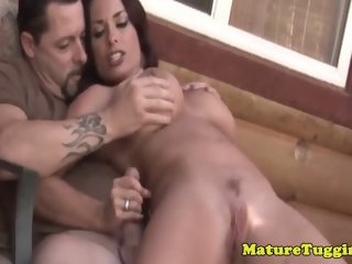 Divine breasty hussy in handjob porn video outside