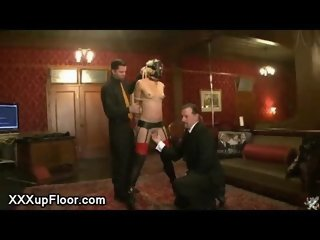 Masked blindfolded babe flogged in the upper floor