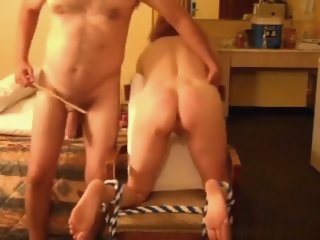 Ponytailed brunette serf milf tied up to a chair gets whipped by her husband and moans