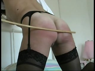 Slave girl gets a hard spanking on all fours