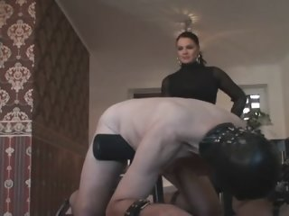 Busty dominatrix spanking her sissy thrall