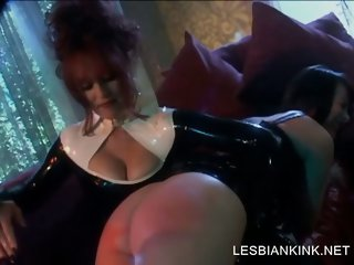 Lesbian scene with tortured slave in latex