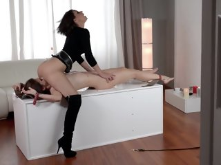 Tall dominatrix tortures her hot slave
