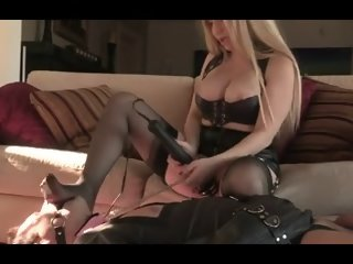 Busty blonde mistress plays with her thrall