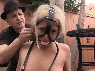 Strapped up blonde in bondage