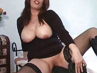 Mature takes on her huge dildo