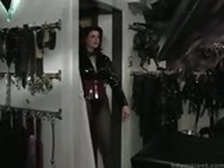 Dominatrix Dresses Up Slave